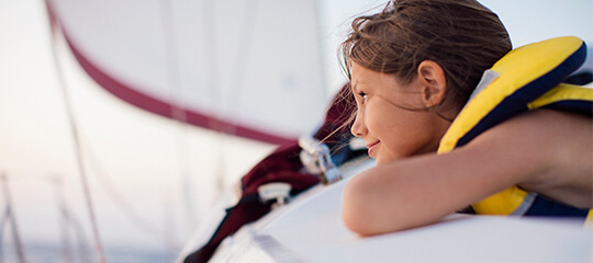 Young girl on a sailboat.