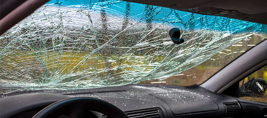 Broken glass on a vehicle windshield.