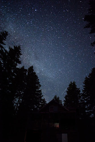 The Milky Way glows above a cabin near Cle Elum, WA