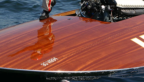Mahogany wood deck of a hydroplane is brown like a parched lawn