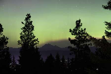 northern lights shimmer over Mt. Stuart in Washington's Cascade Mountains
